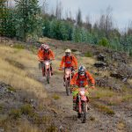 Orange Dirt bike Riders in Enduro track
